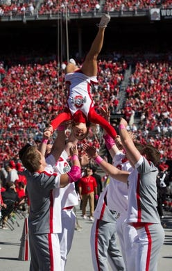 Oct 10, 2015; Columbus, OH, USA; Members of the Ohio State Buckeyes cheerleading squad entertains the fans during the game against the Maryland Terrapins at Ohio Stadium. Ohio State won the game 49-28. Mandatory Credit: Greg Bartram-USA TODAY Sports