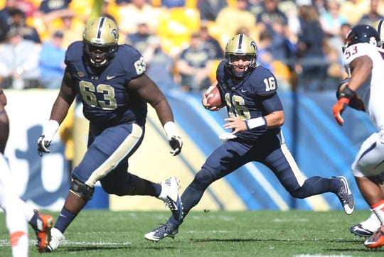 Oct 10, 2015; Pittsburgh, PA, USA; Pittsburgh Panthers quarterback Chad Voytik (16) runs with the ball against the Virginia Cavaliers during the first quarter at Heinz Field.  PITT won 26-19. Mandatory Credit: Charles LeClaire-USA TODAY Sports
