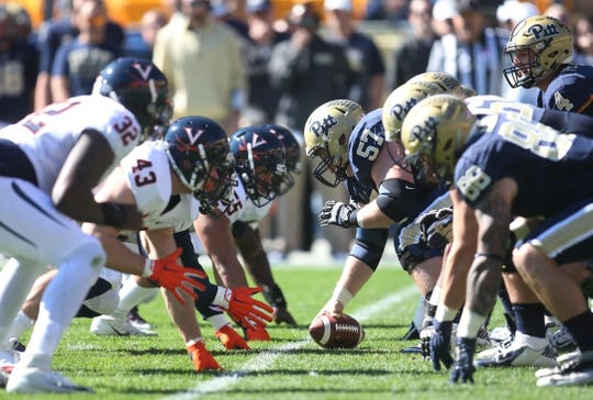 Oct 10, 2015; Pittsburgh, PA, USA; Pittsburgh Panthers center Artie Rowell (57) prepares to hike the ball against the Virginia Cavaliers during the first quarter at Heinz Field. PITT won 26-19. Mandatory Credit: Charles LeClaire-USA TODAY Sports
