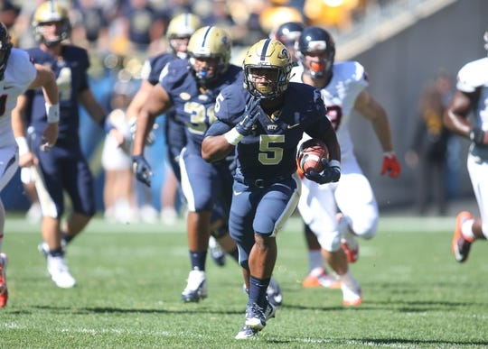 Oct 10, 2015; Pittsburgh, PA, USA; Pittsburgh Panthers running back Chris James (5) carries the ball against the Virginia Cavaliers during the first quarter at Heinz Field.  PITT won 26-19. Mandatory Credit: Charles LeClaire-USA TODAY Sports
