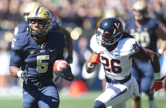 Oct 10, 2015; Pittsburgh, PA, USA; Pittsburgh Panthers running back Chris James (5) carries the ball as Virginia Cavaliers cornerback Maurice Canady (26) pursues  during the first quarter at Heinz Field. PITT won 26-19. Mandatory Credit: Charles LeClaire-USA TODAY Sports