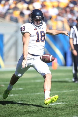 Oct 10, 2015; Pittsburgh, PA, USA; Virginia Cavaliers punter Nicholas Conte (18) punts the ball to the Pittsburgh Panthers during the second quarter at Heinz Field. PITT won 26-19. Mandatory Credit: Charles LeClaire-USA TODAY Sports