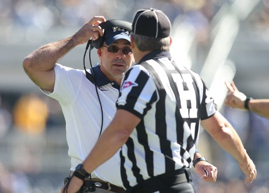 Oct 10, 2015; Pittsburgh, PA, USA; Pittsburgh Panthers head coach Pat Narduzzi (left) reacts as he speaks with head linesman Mike Pavese (right) against the Virginia Cavaliers during the second quarter at Heinz Field. PITT won 26-19. Mandatory Credit: Charles LeClaire-USA TODAY Sports