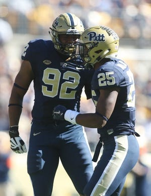 Oct 10, 2015; Pittsburgh, PA, USA; Pittsburgh Panthers defensive lineman Rori Blair (92) and defensive back Pat Amara (25) celebrate a defensive stop against the Virginia Cavaliers during the second quarter at Heinz Field. PITT won 26-19. Mandatory Credit: Charles LeClaire-USA TODAY Sports