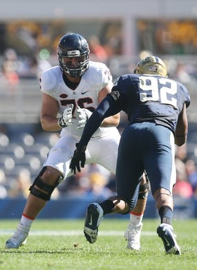 Oct 10, 2015; Pittsburgh, PA, USA; Virginia Cavaliers offensive tackle Michael Mooney (76) blocks at the line of scrimmage against Pittsburgh Panthers defensive lineman Rori Blair (92) during the third quarter at Heinz Field. PITT won 26-19. Mandatory Credit: Charles LeClaire-USA TODAY Sports