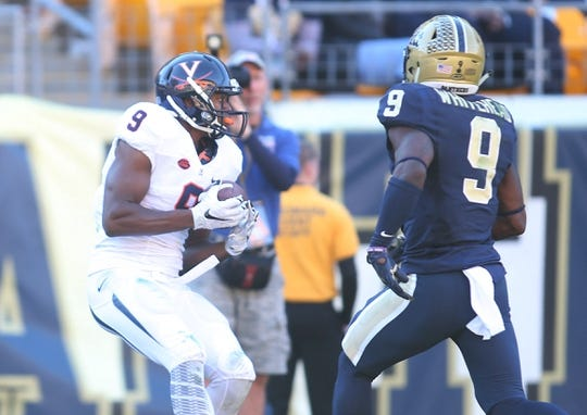 Oct 10, 2015; Pittsburgh, PA, USA; Virginia Cavaliers wide receiver Canaan Severin (left) catches a touchdown pass against Pittsburgh Panthers defensive back Jordan Whitehead (right) during the fourth quarter at Heinz Field. PITT won 26-19. Mandatory Credit: Charles LeClaire-USA TODAY Sports