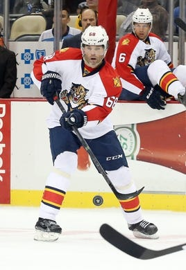 Oct 20, 2015; Pittsburgh, PA, USA; Florida Panthers right wing Jaromir Jagr (68) passes the puck against the Pittsburgh Penguins during the second period at the CONSOL Energy Center. Mandatory Credit: Charles LeClaire-USA TODAY Sports
