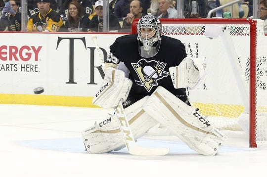 Oct 20, 2015; Pittsburgh, PA, USA; Pittsburgh Penguins goalie Marc-Andre Fleury (29) prepares to make a save against the Florida Panthers during the second period at the CONSOL Energy Center. Mandatory Credit: Charles LeClaire-USA TODAY Sports