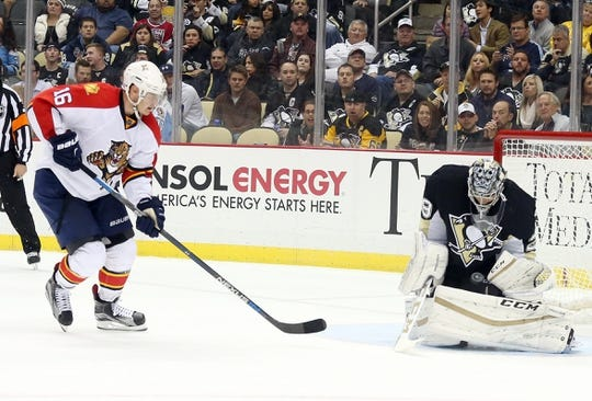 Oct 20, 2015; Pittsburgh, PA, USA; Pittsburgh Penguins goalie Marc-Andre Fleury (29) makes a save as Florida Panthers center Aleksander Barkov (16) looks for a rebound during the second period at the CONSOL Energy Center. Mandatory Credit: Charles LeClaire-USA TODAY Sports
