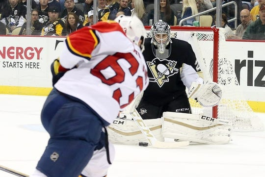 Oct 20, 2015; Pittsburgh, PA, USA; Pittsburgh Penguins goalie Marc-Andre Fleury (29) makes a save against Florida Panthers center Dave Bolland (63) during the second period at the CONSOL Energy Center. Mandatory Credit: Charles LeClaire-USA TODAY Sports