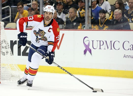 Oct 20, 2015; Pittsburgh, PA, USA; Florida Panthers defenseman Willie Mitchell (33) moves the puck against the Pittsburgh Penguins during the third period at the CONSOL Energy Center. The Penguins won 3-2 in overtime. Mandatory Credit: Charles LeClaire-USA TODAY Sports