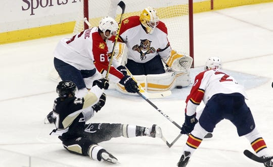 Oct 20, 2015; Pittsburgh, PA, USA; Florida Panthers goalie Roberto Luongo (1) makes a save against Pittsburgh Penguins right wing Bryan Rust (17) during the second period at the CONSOL Energy Center. The Penguins won 3-2 in overtime. Mandatory Credit: Charles LeClaire-USA TODAY Sports