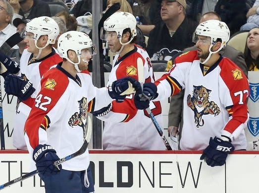 Oct 20, 2015; Pittsburgh, PA, USA; Florida Panthers center Quinton Howden (42) celebrates with center Brandon Pirri (73) after Howden scored a goal against the Pittsburgh Penguins during the second period at the CONSOL Energy Center. The Penguins won 3-2 in overtime. Mandatory Credit: Charles LeClaire-USA TODAY Sports
