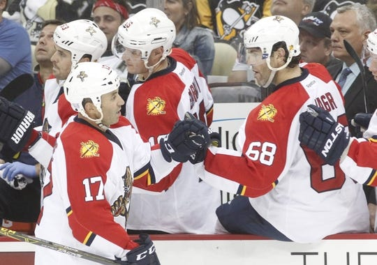 Oct 20, 2015; Pittsburgh, PA, USA; Florida Panthers center Derek MacKenzie (17) celebrates with right wing Jaromir Jagr (68) after MacKenzie scored a goal against the Pittsburgh Penguins during the third period at the CONSOL Energy Center. The Penguins won 3-2 in overtime. Mandatory Credit: Charles LeClaire-USA TODAY Sports