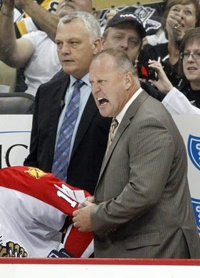 Oct 20, 2015; Pittsburgh, PA, USA; Florida Panthers head coach Gerard Gallant (right) reacts on the bench as assistant coach Mike Kelly (left) looks on against the Pittsburgh Penguins during the third period at the CONSOL Energy Center. The Penguins won 3-2 in overtime. Mandatory Credit: Charles LeClaire-USA TODAY Sports