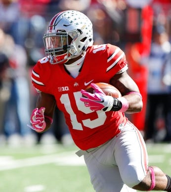 Oct 10, 2015; Columbus, OH, USA; Ohio State Buckeyes running back Ezekiel Elliott (15) runs during the first half versus the Maryland Terrapins at Ohio Stadium. Ohio State won the game 49-28. Mandatory Credit: Joe Maiorana-USA TODAY Sports