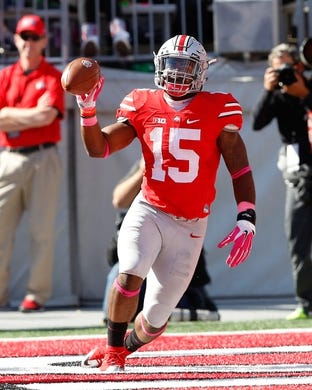 Oct 10, 2015; Columbus, OH, USA; Ohio State Buckeyes running back Ezekiel Elliott (15) following his first half touchdown versus the Maryland Terrapins at Ohio Stadium. Ohio State won the game 49-28. Mandatory Credit: Joe Maiorana-USA TODAY Sports