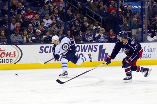 Oct 31, 2015; Columbus, OH, USA; Winnipeg Jets center Bryan Little (18) scores on this shot against the Columbus Blue Jackets during the first period at Nationwide Arena. Mandatory Credit: Russell LaBounty-USA TODAY Sports