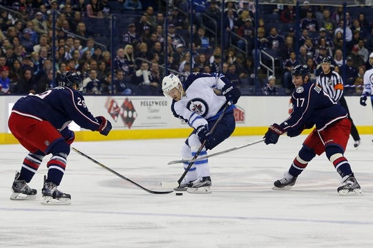 Oct 31, 2015; Columbus, OH, USA; Columbus Blue Jackets center Brandon Dubinsky (17) defends Winnipeg Jets center Bryan Little (18) during the first period at Nationwide Arena. Mandatory Credit: Russell LaBounty-USA TODAY Sports