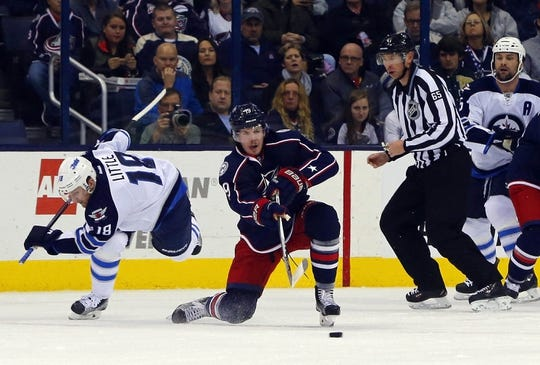 Oct 31, 2015; Columbus, OH, USA; Columbus Blue Jackets center Ryan Johansen (19) passes the puck against the Winnipeg Jets during the first period at Nationwide Arena. Mandatory Credit: Russell LaBounty-USA TODAY Sports