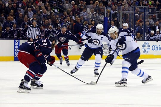 Oct 31, 2015; Columbus, OH, USA; Winnipeg Jets center Bryan Little (18) takes a shot against the Columbus Blue Jackets during the first period at Nationwide Arena. Mandatory Credit: Russell LaBounty-USA TODAY Sports