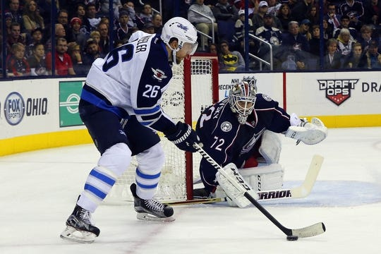Oct 31, 2015; Columbus, OH, USA; Winnipeg Jets right wing Blake Wheeler (26) controls the puck against the Columbus Blue Jackets during the first period at Nationwide Arena. Mandatory Credit: Russell LaBounty-USA TODAY Sports