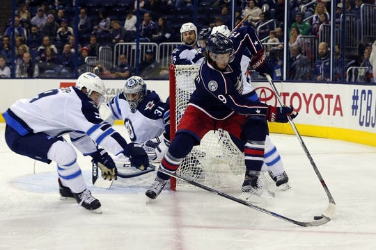 Oct 31, 2015; Columbus, OH, USA; Columbus Blue Jackets center Ryan Johansen (19) controls the puck as Winnipeg Jets center Andrew Copp (9) defends during the second period at Nationwide Arena. Mandatory Credit: Russell LaBounty-USA TODAY Sports