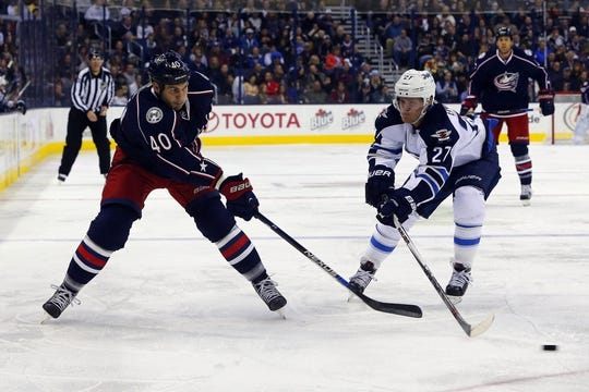 Oct 31, 2015; Columbus, OH, USA; Columbus Blue Jackets right wing Jared Boll (40) passes the puck against Winnipeg Jets left wing Nikolaj Ehlers (27) during the second period at Nationwide Arena. Mandatory Credit: Russell LaBounty-USA TODAY Sports