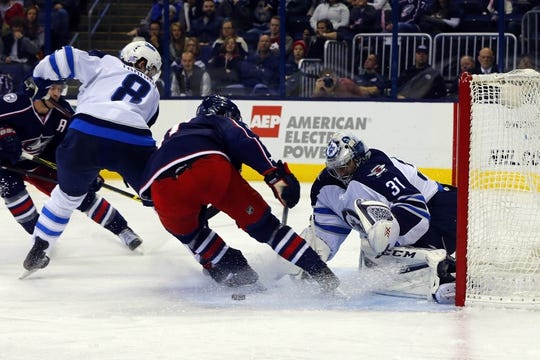 Oct 31, 2015; Columbus, OH, USA; Winnipeg Jets goalie Ondrej Pavelec (31) makes a save against Columbus Blue Jackets center Alexander Wennberg (41) during the second period at Nationwide Arena. Mandatory Credit: Russell LaBounty-USA TODAY Sports