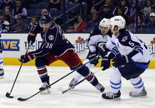 Oct 31, 2015; Columbus, OH, USA; Columbus Blue Jackets center Boone Jenner (38) skates with the puck as Winnipeg Jets defenseman Mark Stuart (5) defends during the second period at Nationwide Arena. Mandatory Credit: Russell LaBounty-USA TODAY Sports