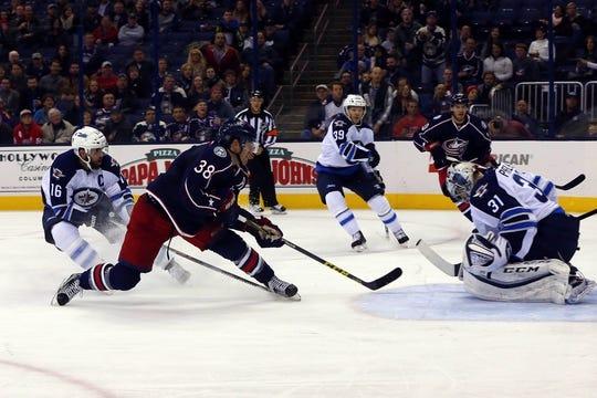 Oct 31, 2015; Columbus, OH, USA; Columbus Blue Jackets center Boone Jenner (38) tips the puck on goal against Winnipeg Jets goalie Ondrej Pavelec (31) during the second period at Nationwide Arena. Mandatory Credit: Russell LaBounty-USA TODAY Sports