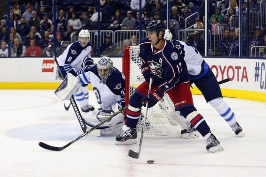Oct 31, 2015; Columbus, OH, USA; Columbus Blue Jackets center Brandon Dubinsky (17) looks to pass against the Winnipeg Jets during the second period at Nationwide Arena. Mandatory Credit: Russell LaBounty-USA TODAY Sports