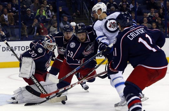 Oct 31, 2015; Columbus, OH, USA; Columbus Blue Jackets goalie Curtis McElhinney (30) makes a save against the Winnipeg Jets during the third period at Nationwide Arena. Winnipeg defeated Columbus 3-2. Mandatory Credit: Russell LaBounty-USA TODAY Sports