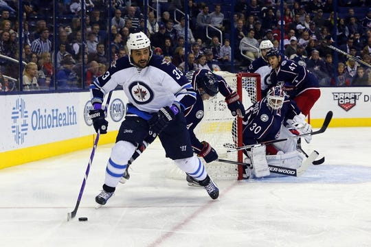 Oct 31, 2015; Columbus, OH, USA; Winnipeg Jets defenseman Dustin Byfuglien (33) looks to pass against the Columbus Blue Jackets during the third period at Nationwide Arena. Winnipeg defeated Columbus 3-2. Mandatory Credit: Russell LaBounty-USA TODAY Sports