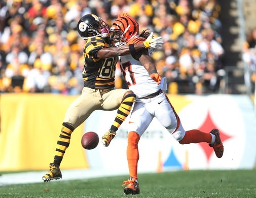 Nov 1, 2015; Pittsburgh, PA, USA; Cincinnati Bengals cornerback Dre Kirkpatrick (27) commits pass interference against Pittsburgh Steelers wide receiver Antonio Brown (84) during the first quarter at Heinz Field. Mandatory Credit: Charles LeClaire-USA TODAY Sports