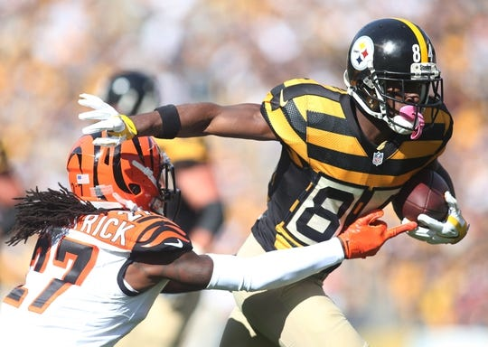 Nov 1, 2015; Pittsburgh, PA, USA; Pittsburgh Steelers wide receiver Antonio Brown (84) runs after a pass reception as Cincinnati Bengals cornerback Dre Kirkpatrick (27) defends during the first quarter at Heinz Field. Mandatory Credit: Charles LeClaire-USA TODAY Sports