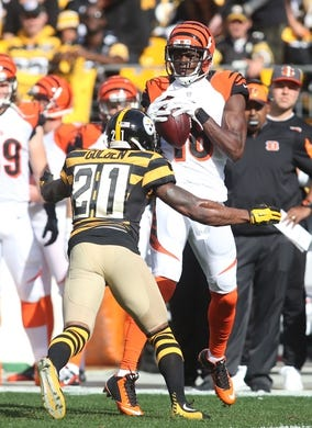 Nov 1, 2015; Pittsburgh, PA, USA; Cincinnati Bengals wide receiver A.J. Green (18) catches a pass as Pittsburgh Steelers strong safety Robert Golden (L) defends during the first quarter at Heinz Field. Mandatory Credit: Charles LeClaire-USA TODAY Sports