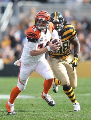 Nov 1, 2015; Pittsburgh, PA, USA; Cincinnati Bengals quarterback Andy Dalton (14) runs the ball as Pittsburgh Steelers linebacker Bud Dupree (48) chases during the first quarter at Heinz Field. Mandatory Credit: Charles LeClaire-USA TODAY Sports
