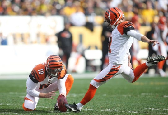 Nov 1, 2015; Pittsburgh, PA, USA; Cincinnati Bengals kicker Mike Nugent (2) kicks a forty-four yard field goal from the hold of punter Kevin Huber (10) against the Pittsburgh Steelers during the first quarter at Heinz Field. Mandatory Credit: Charles LeClaire-USA TODAY Sports