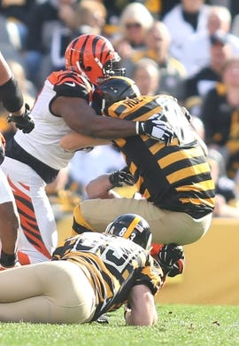Nov 1, 2015; Pittsburgh, PA, USA; Pittsburgh Steelers quarterback Ben Roethlisberger (7) is sacked by the Cincinnati Bengals defense during the second quarter at Heinz Field. Mandatory Credit: Charles LeClaire-USA TODAY Sports