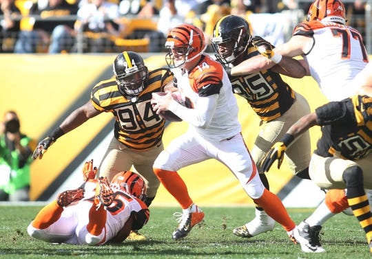 Nov 1, 2015; Pittsburgh, PA, USA; Pittsburgh Steelers inside linebacker Lawrence Timmons (94) and outside linebacker Jarvis Jones (95) combine to sack Cincinnati Bengals quarterback Andy Dalton (14) during the second quarter at Heinz Field. Mandatory Credit: Charles LeClaire-USA TODAY Sports