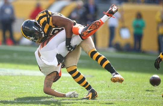 Nov 1, 2015; Pittsburgh, PA, USA; Pittsburgh Steelers free safety Mike Mitchell (23) separates Cincinnati Bengals wide receiver Marvin Jones (82) from the ball during the second quarter at Heinz Field. Mandatory Credit: Charles LeClaire-USA TODAY Sports