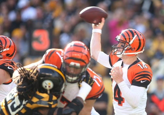 Nov 1, 2015; Pittsburgh, PA, USA; Cincinnati Bengals quarterback Andy Dalton (14) passes against the Pittsburgh Steelers during the first quarter at Heinz Field. Mandatory Credit: Charles LeClaire-USA TODAY Sports
