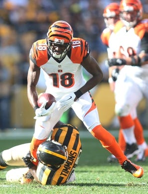 Nov 1, 2015; Pittsburgh, PA, USA; Cincinnati Bengals wide receiver A.J. Green (18) runs after a pass reception as Pittsburgh Steelers inside linebacker Lawrence Timmons (94) defends during the second quarter at Heinz Field. Mandatory Credit: Charles LeClaire-USA TODAY Sports