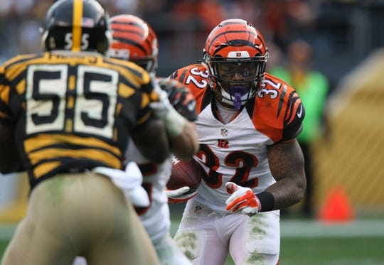 Nov 1, 2015; Pittsburgh, PA, USA; Cincinnati Bengals half back Jeremy Hill (32) runs the ball against the Pittsburgh Steelers during the second half at Heinz Field. The Bengals won the game 16-10. Mandatory Credit: Jason Bridge-USA TODAY Sports