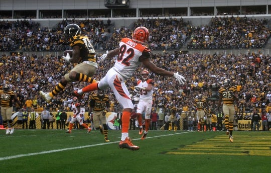 Nov 1, 2015; Pittsburgh, PA, USA; Pittsburgh Steelers cornerback Antwon Blake (41) intercepts a pass in front of Cincinnati Bengals wide receiver Marvin Jones (82) during the second half at Heinz Field. The Bengals won the game 16-10. Mandatory Credit: Jason Bridge-USA TODAY Sports