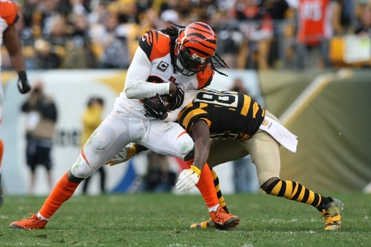 Nov 1, 2015; Pittsburgh, PA, USA; Cincinnati Bengals safety Reggie Nelson (20) returns an interception as he is hit by Pittsburgh Steelers wide receiver Antonio Brown (84) during the second half at Heinz Field. The Bengals won the game 16-10. Mandatory Credit: Jason Bridge-USA TODAY Sports