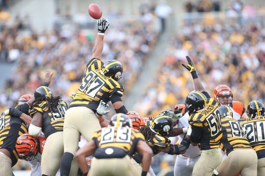 Nov 1, 2015; Pittsburgh, PA, USA; Pittsburgh Steelers defensive end Cameron Heyward (97) blocks a Cincinnati Bengals field goal attempt during the third quarter at Heinz Field. The Bengals won 16-10. Mandatory Credit: Charles LeClaire-USA TODAY Sports