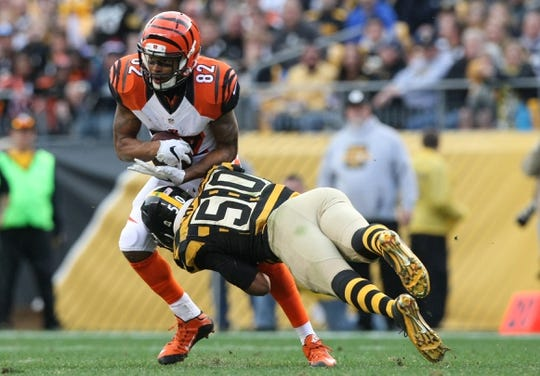 Nov 1, 2015; Pittsburgh, PA, USA; Cincinnati Bengals wide receiver Marvin Jones (82) is tackled by Pittsburgh Steelers linebacker Ryan Shazier (50) during the second half at Heinz Field. The Bengals won the game 16-10. Mandatory Credit: Jason Bridge-USA TODAY Sports