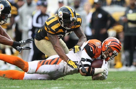 Nov 1, 2015; Pittsburgh, PA, USA; Cincinnati Bengals tight end Tyler Eifert (85) is brought down by Pittsburgh Steelers safety Robert Golden (21) during the second half at Heinz Field. The Bengals won the game 16-10. Mandatory Credit: Jason Bridge-USA TODAY Sports